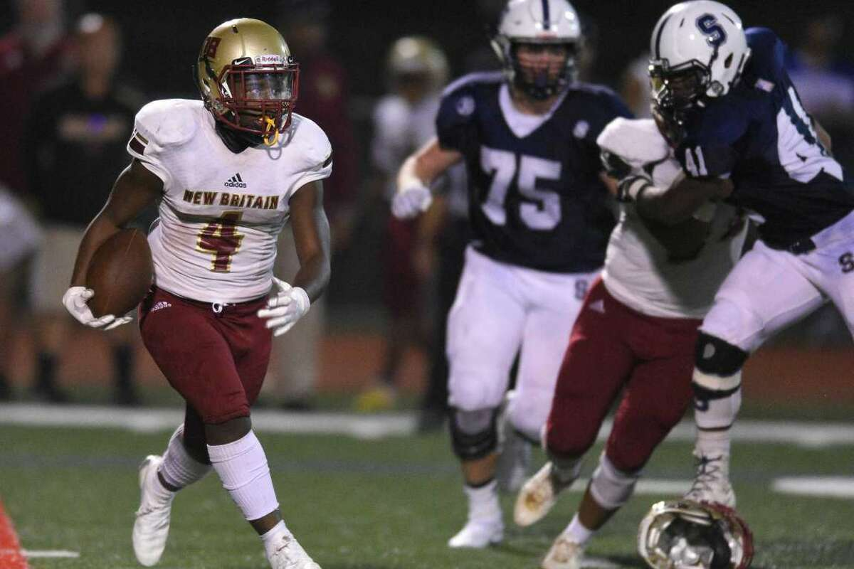 New Britain's Cameron Boyd runs the ball against Staples on Sept. 21, 2019. Boyd will be in the backfield for the Golden Hurricanes this season.