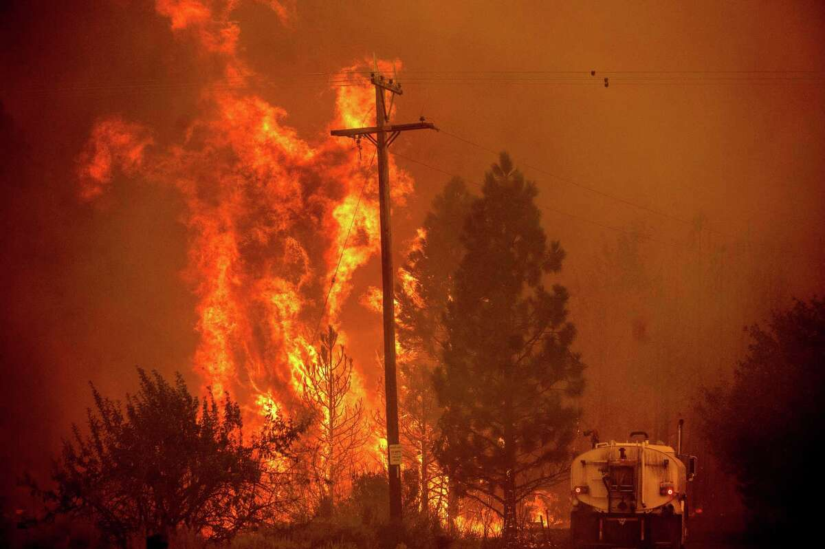 The Dixie Fire burns south of Janesville in Lassen County on Tuesday.