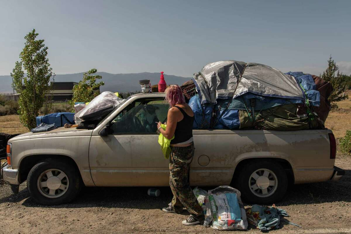 Regina Rutledge packs up her truck Wednesday as she and others prepare to return to the town of Chester after staying several weeks at an evacuation shelter in Susanville after fleeing Dixie Fire.