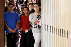 Students at Hackett Middle School peer out of their classroom on Friday, Feb. 1, 2019, in Albany, N.Y. From 2010 to 2020, New York's youth population decreased in size, but it grew more ethnically and racially diverse, according to new 2020 Census data.