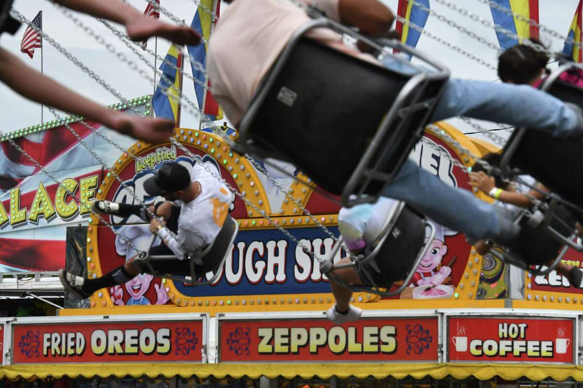 Thrill seekers enjoy a carnival ride at the Altamont Fair on Wednesday, Aug. 18, 2021, in Altamont, N.Y. The fair runs through Sunday.
