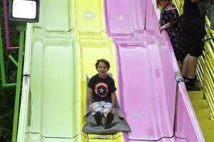 Miles Schofield, 7, of Rensselaerville enjoys an amusement ride at the Altamont Fair on Wednesday, Aug. 18, 2021, in Altamont, N.Y. The fair runs through Sunday.