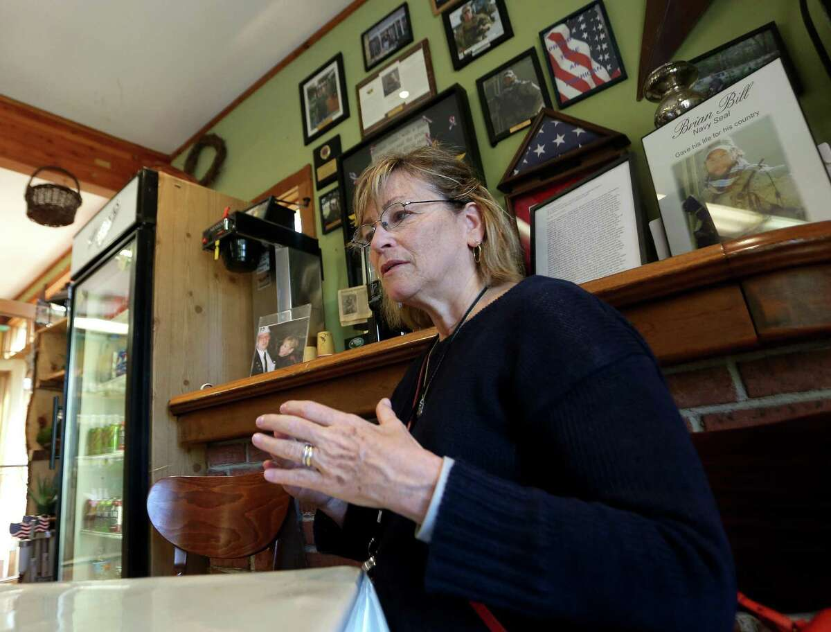 Pat Parry, mother of Brian Bill, a Stamford resident killed in Afghanistan, discusses her son as a man and as a Navy Seal during a sit down with local veterans inside the Springdale Florist on Monday, May 23, 2016.