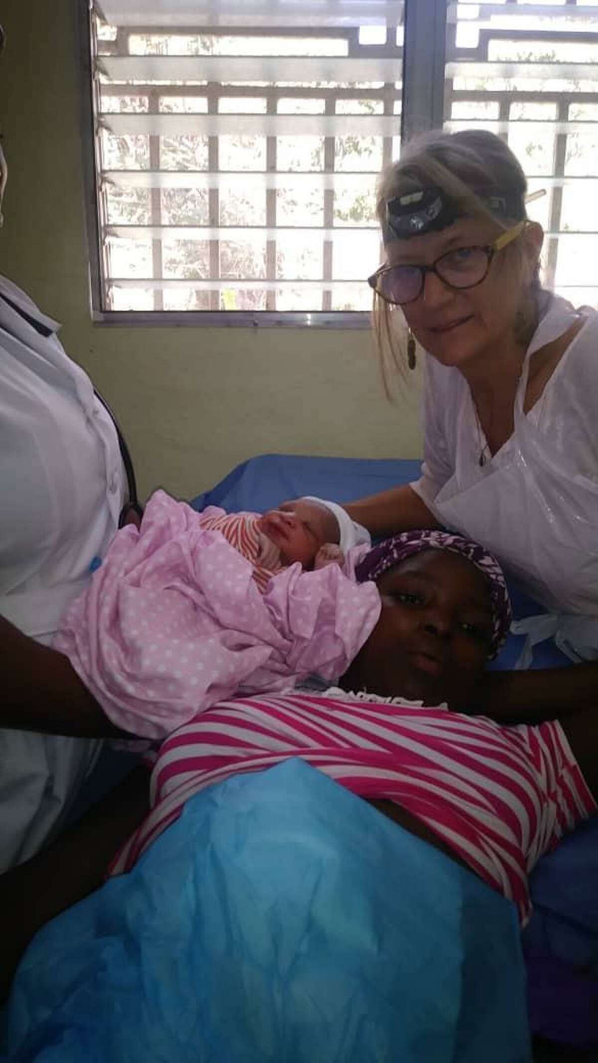 A mom, newborn and Lindenmeyr - minutes after giving birth at the healthcare clinic