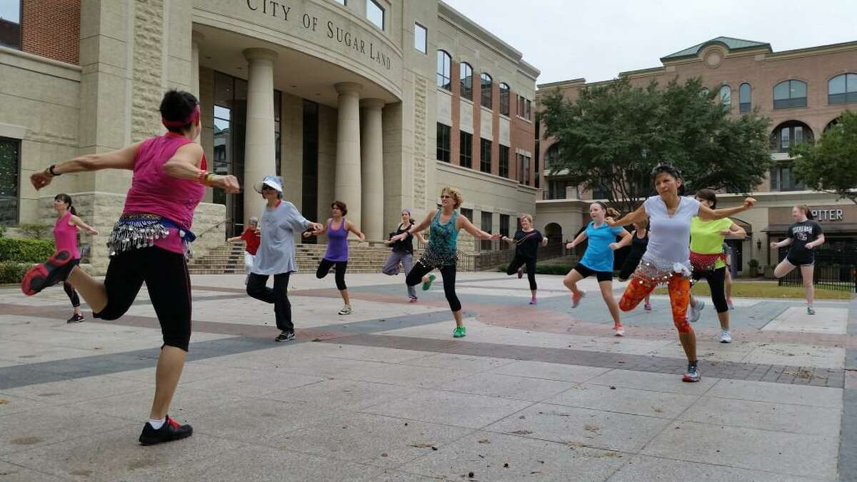 Zumba with Cida Fitness at Sugar Land Town Square.