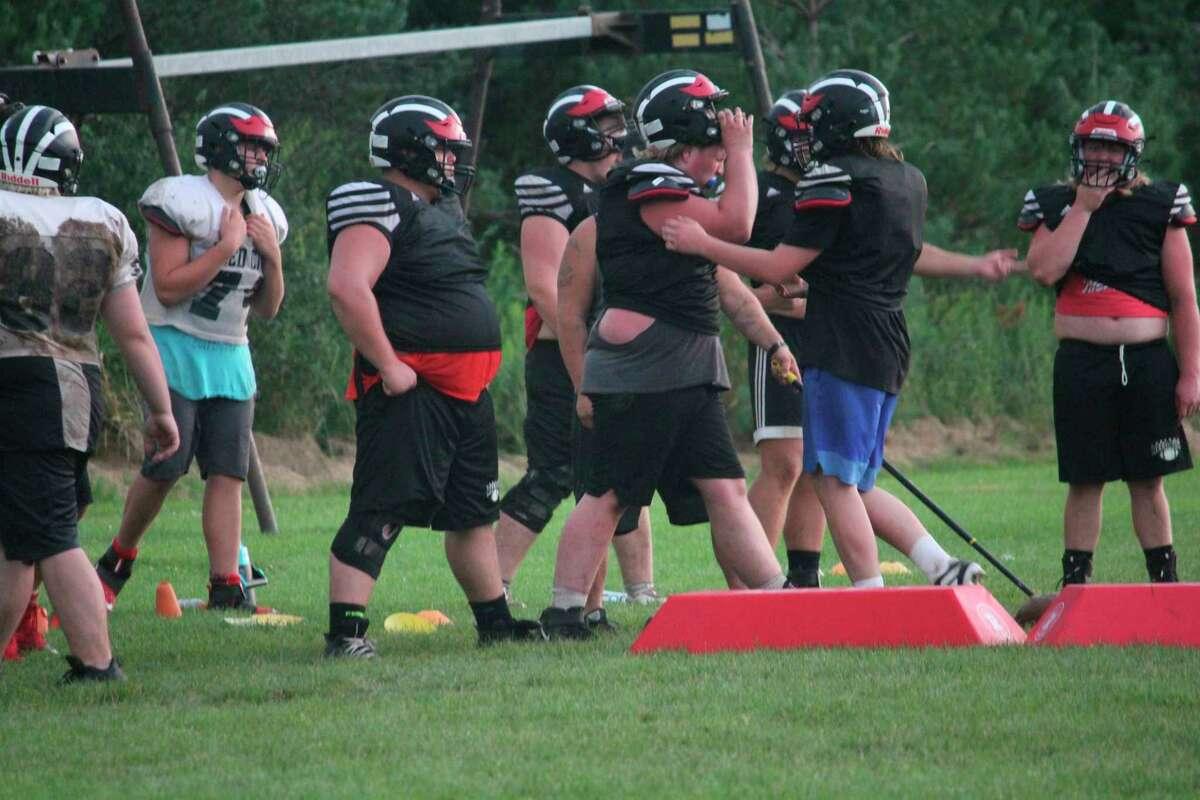 Reed City football players go through practice drills last week. (Pioneer photo/John Raffel)