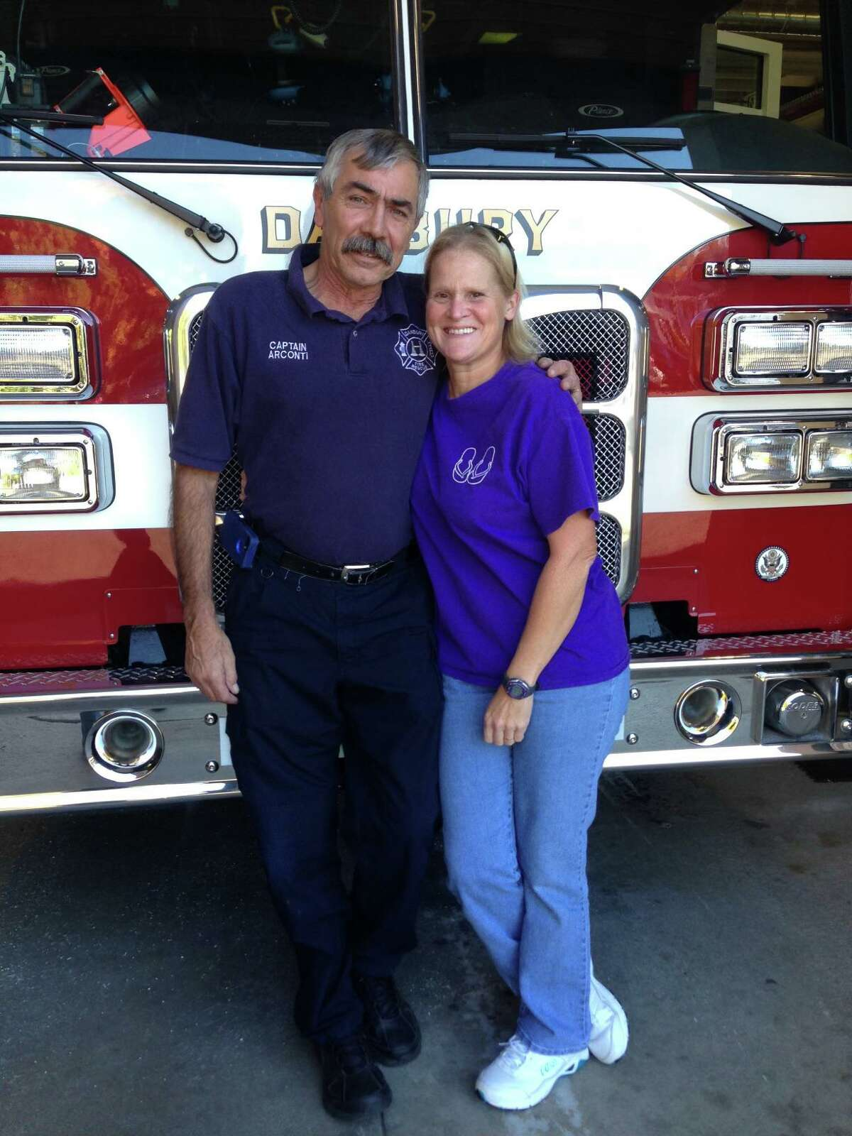 Former Danbury Fire Capt. Gary Arconti with his wife, Lori Arconti, a retired fire lieutenant. Gary Arconti died on Aug. 8 at 67.