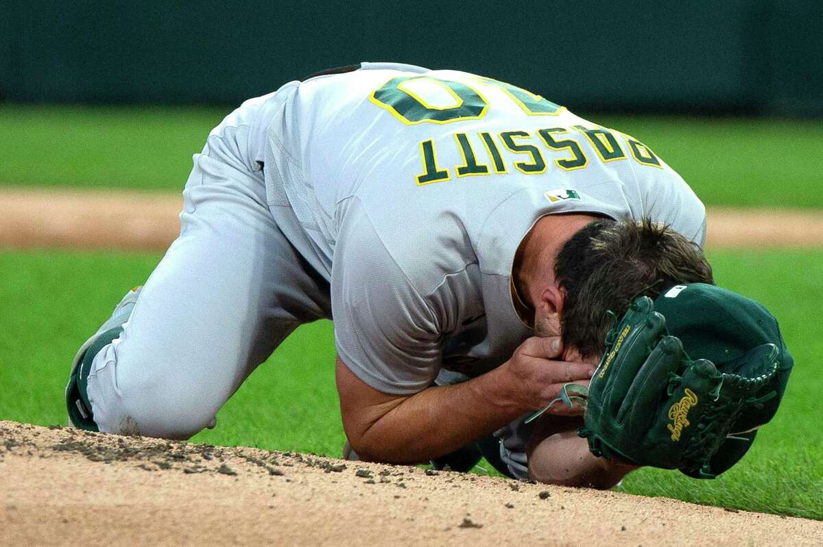 Oakland Athletics starting pitcher Chris Bassitt (40) holds his hands to his face after getting hit by a ball from batter Chicago White Sox left fielder Brian Goodwin (18) during the second inning on Tuesday, August 17, 2021, at Guaranteed Rate Field in Chicago. (Erin Hooley/Chicago Tribune/TNS)