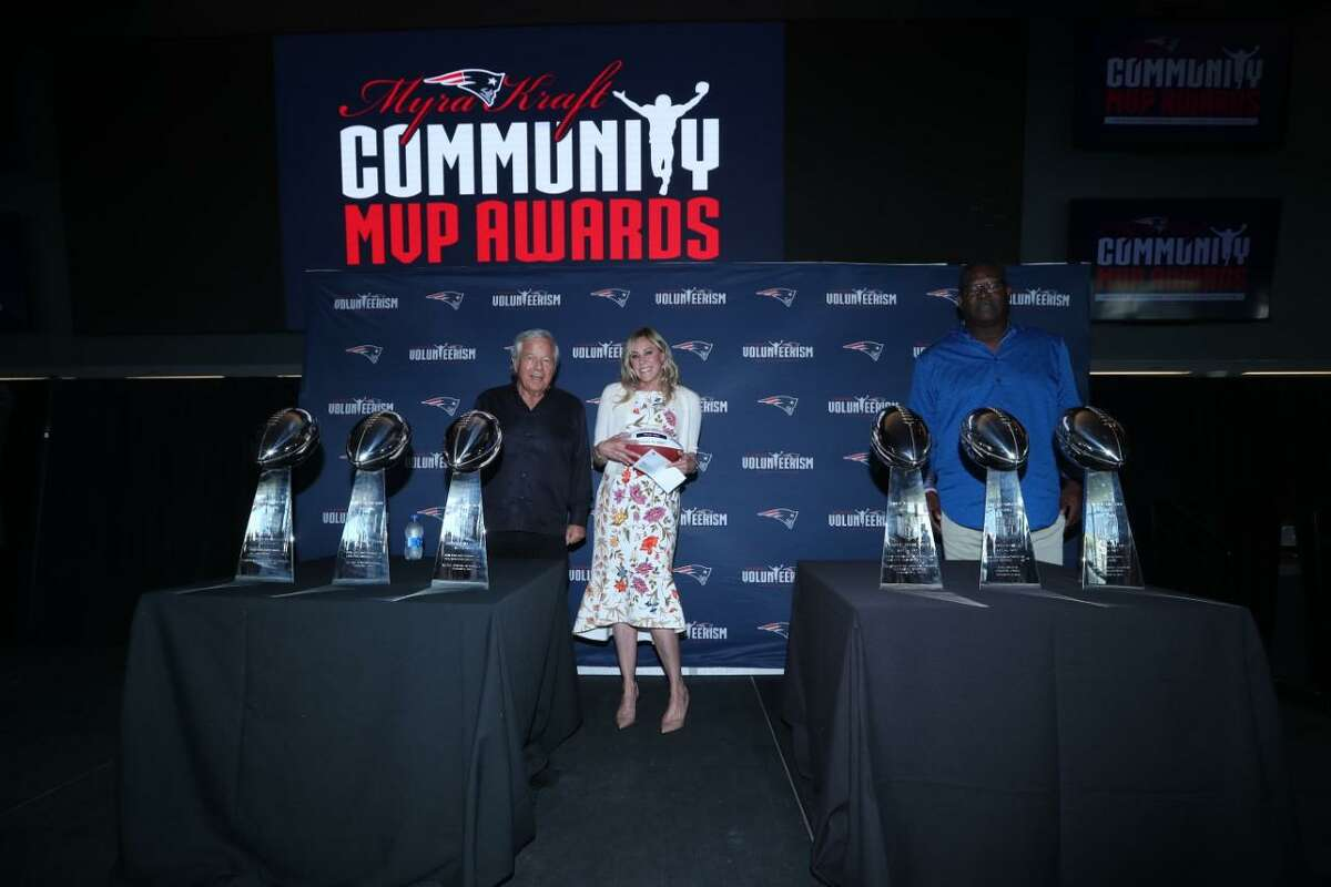 Patriots Chairman and CEO Robert Kraft and Patriots and Pro Football Hall of Famer Andre Tippett congratulate Amy Katz from Westport, Conn. for being selected as a 2021 Myra Kraft Community MVP Award winner. During the Wednesday, August 11, luncheon, the Kraft family, and the New England Patriots Foundation awarded $275,000 in grants to 26 New England non-profit organizations. Pink Aid received a $10,000 grant in honor of Katz' volunteer efforts.