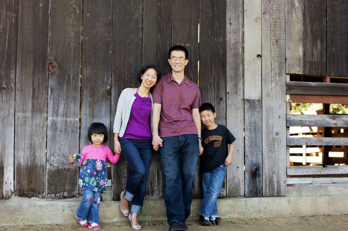 Catherine and William Kuo, with their children, Natalie and Thomas, pose for a photo. Catherine Kuo died in March after being crushed between two cars at a food giveaway in Dublin. Her husband and children have filed a claim against the Dublin Unified School District.