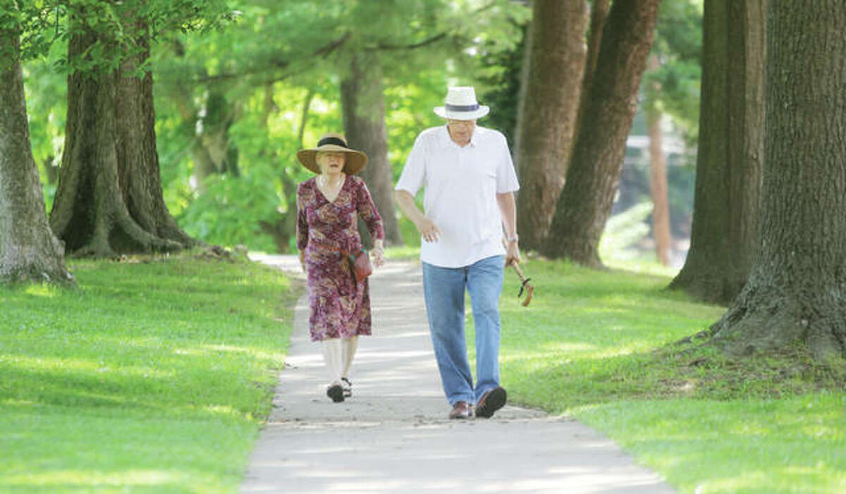 Former State Sen. Bill Haine and his wife, Anna, walk around Haskell Park in June 2018.