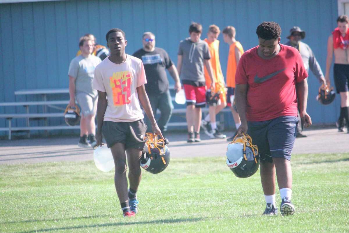 Baldwin's Carmelo Lindsey (left) and Brian Flowers come off the practice field on Tuesday. (Pioneer photo/John Raffel)