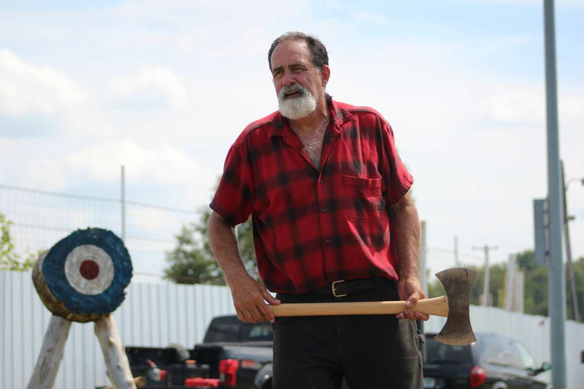 AJ Fletcher, of Cobleskill, New York, and Dan McDonough, of Mackinac City, demonstrated turn of the century skills including chopping, sawing, axe throwing, cross-cut sawing and logrolling during the Jack Pine Lumberjack Show on Wednesday during the Manistee County Fair.