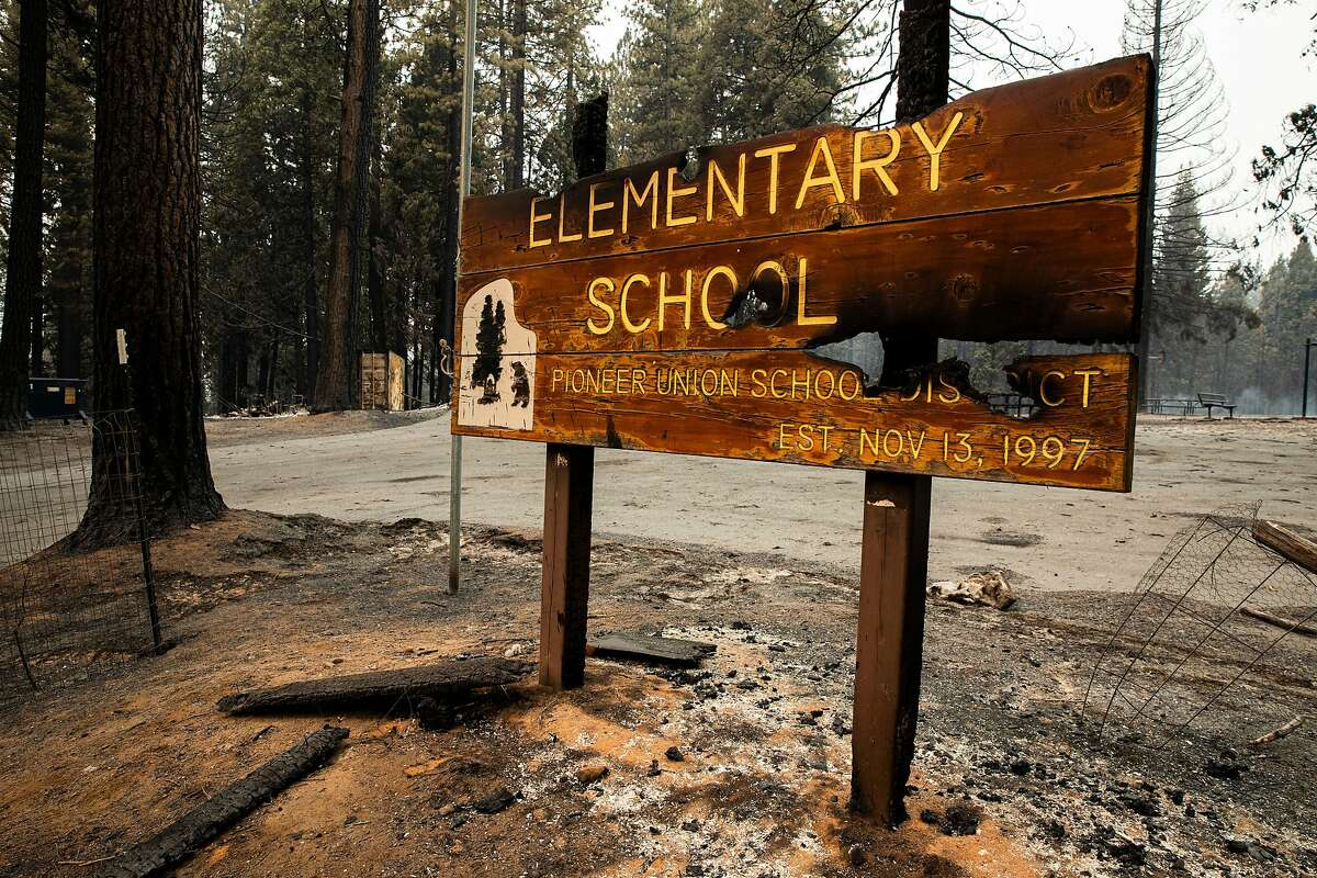 The Walt Tyler Elementary School sign bears witness to the Caldor Fire's destruction in Grizzly Flats.