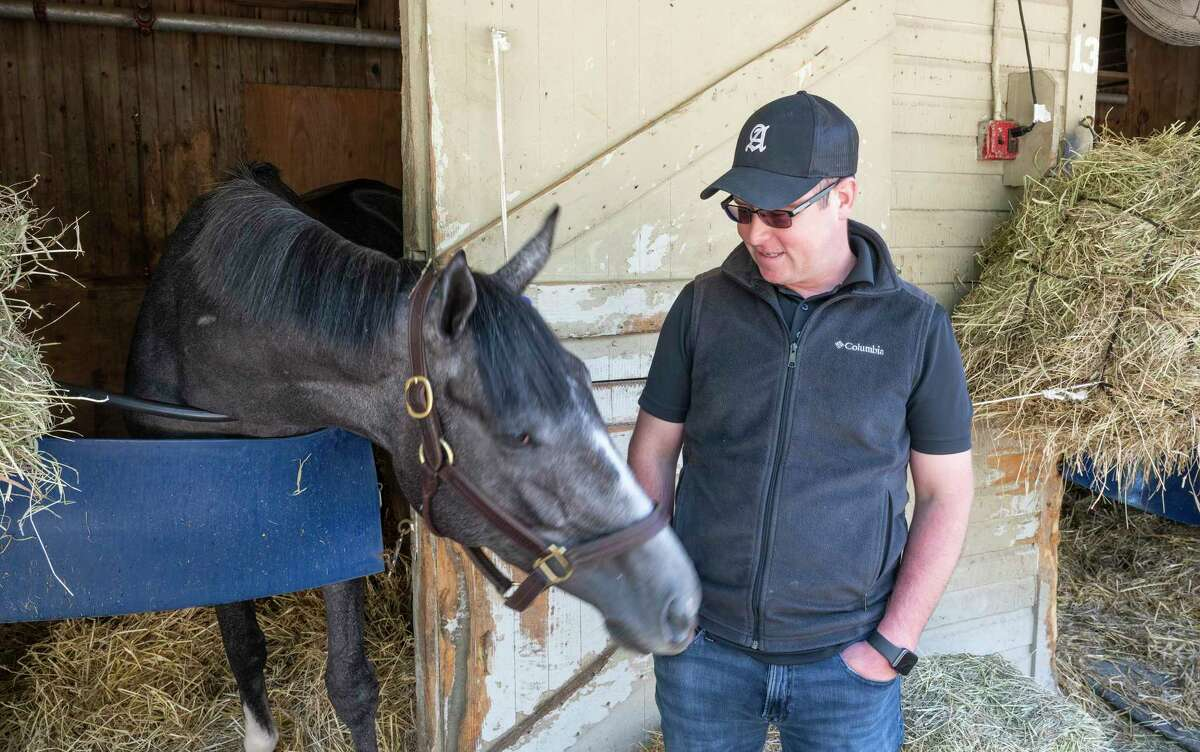Rob Atras with his filly Maracuja at the barn at Saratoga Race Course on Sunday, Aug. 15, 2021, in Saratoga Springs, N.Y.