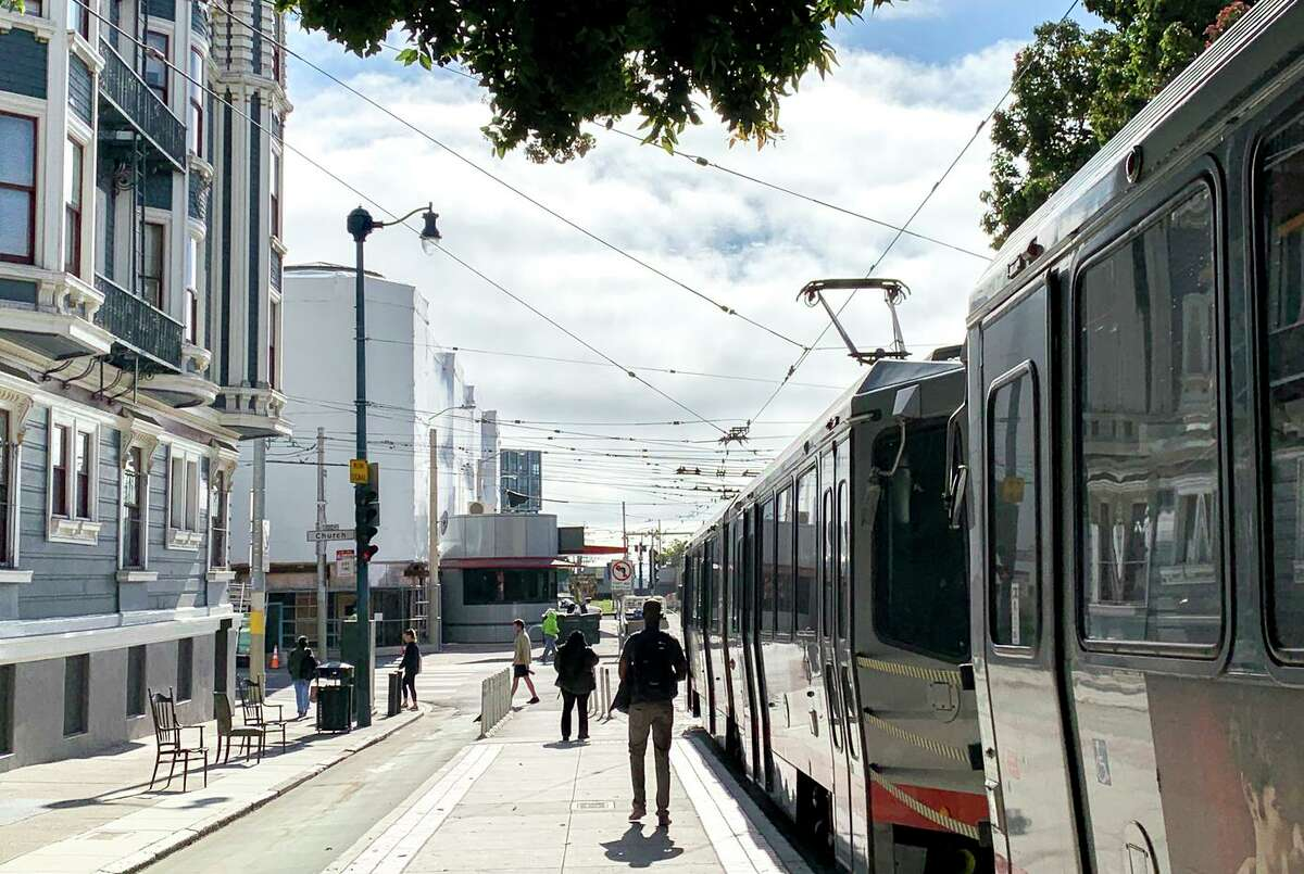 Commuters exit an N-Judah Muni Metro train in San Francisco. Under a proposed plan by the city, Muni Metro would expand lines into the north and west areas of San Francisco.