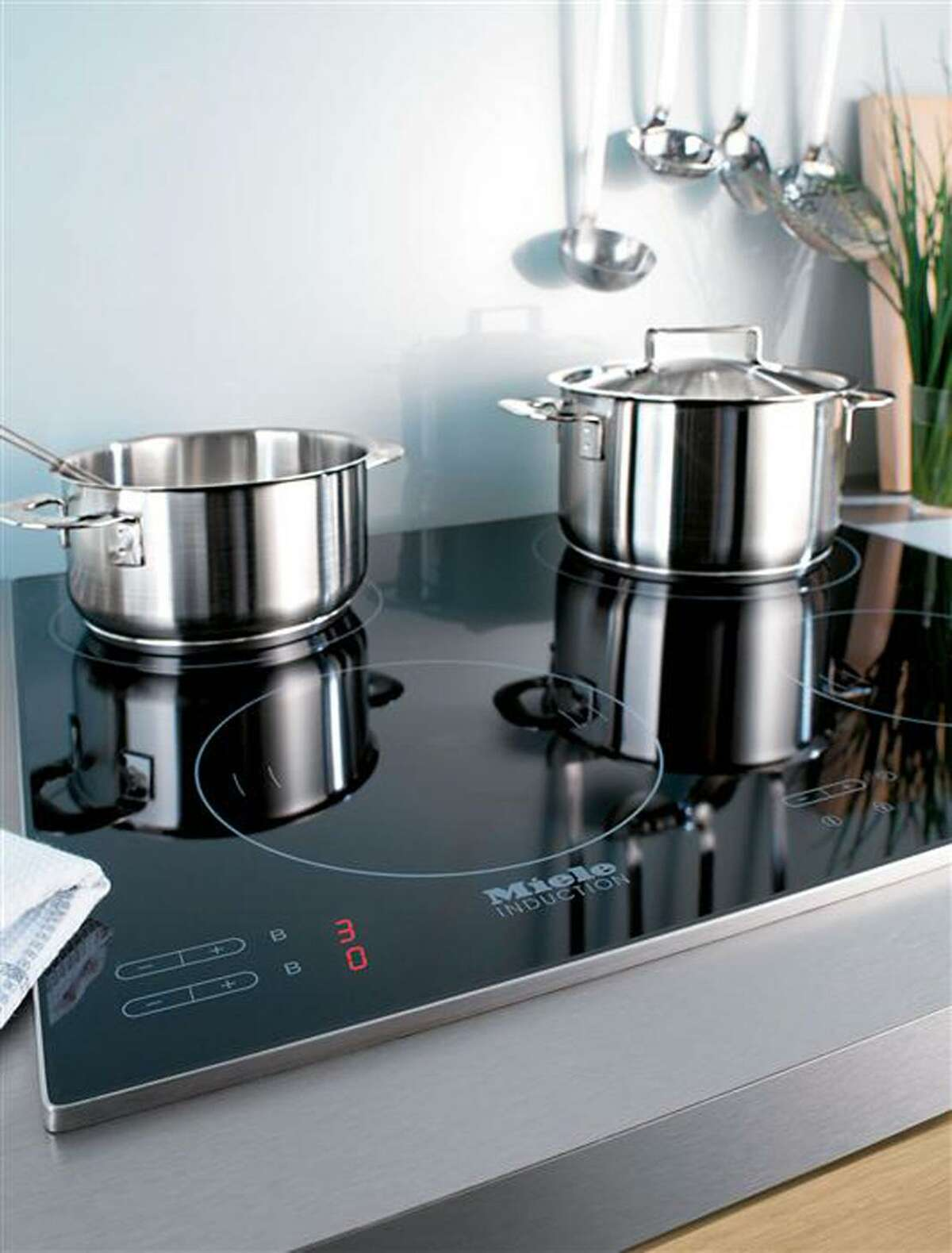 An induction stove. Making buildings all-electric to cut carbon emissions won't be as simple as it sounds.