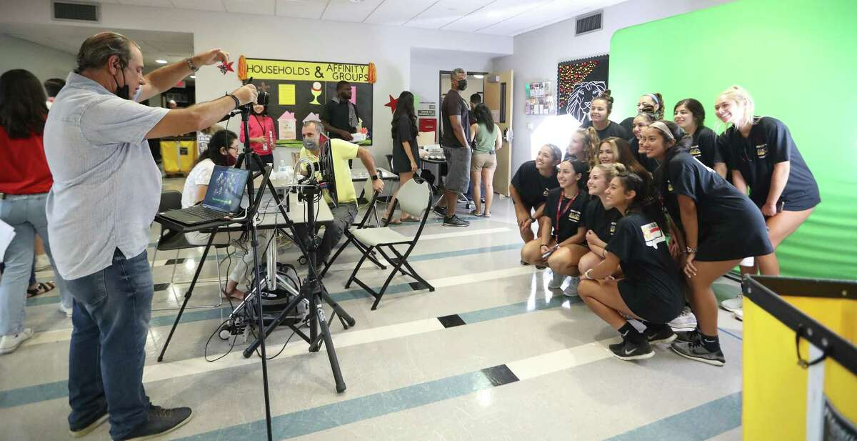 Students get their photo taken as students moved into the dorm at the Guinan Residence Hall on the University of St. Thomas campus, Wednesday, August 18, 2021, in Houston.