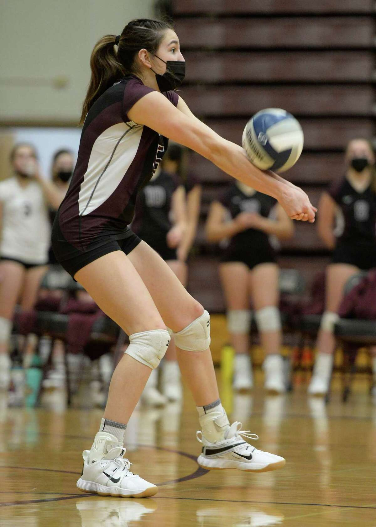 Burnt Hills'Callie Chevalier bumps the ball during a match in March. Volleyball players might have to wear masks this season, Section II Executive Director Ed Dopp said.