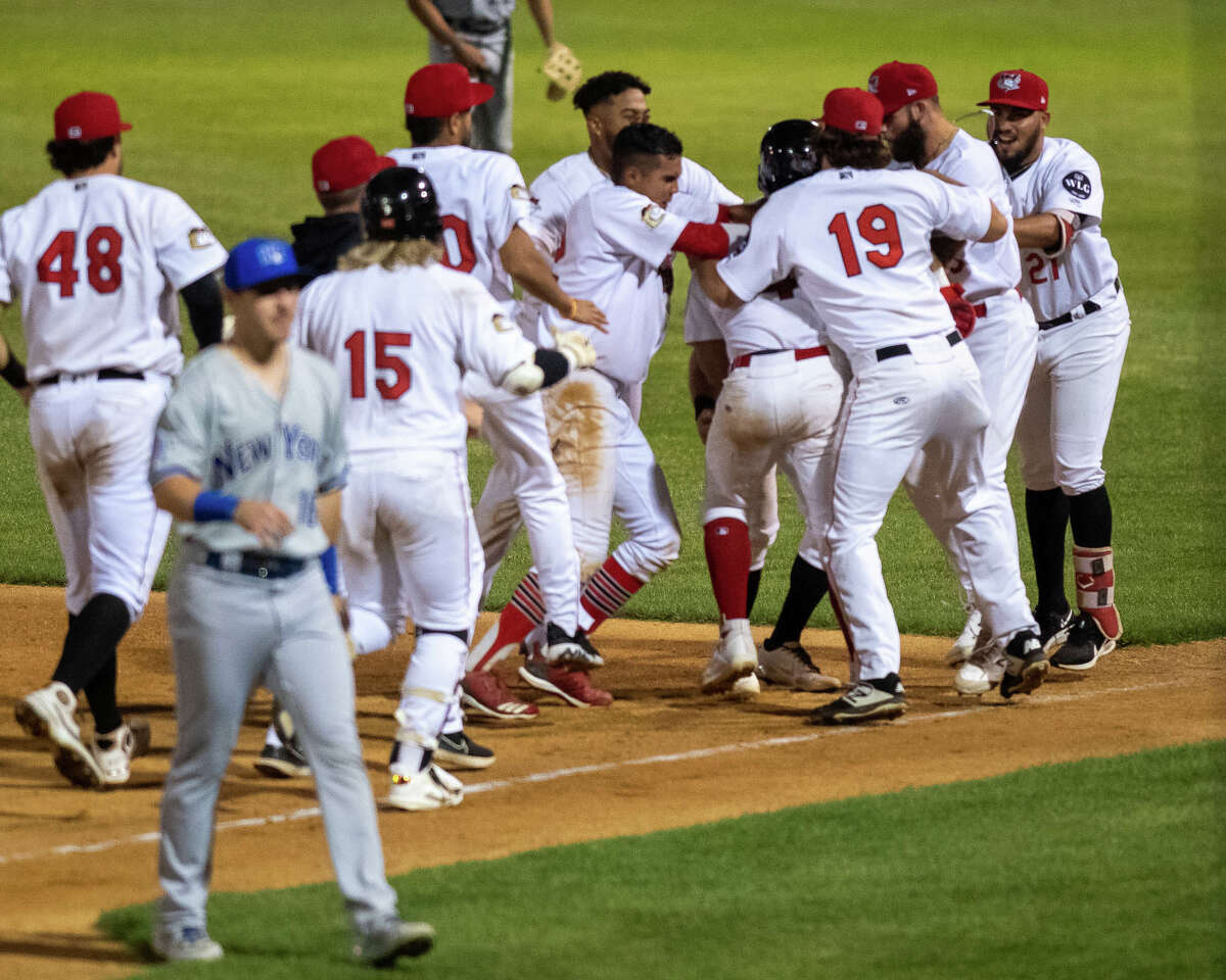 The Tri-City ValleyCats mob Luis Roman after he hit a walk-off single to beat the New York Boulders at Joseph L. Bruno Stadium on Wednesday, Aug. 18, 2021.
