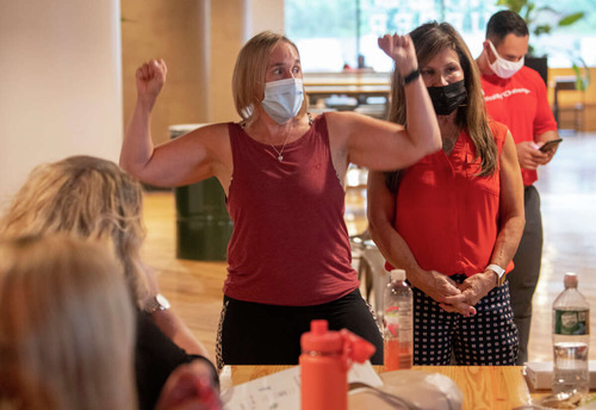 Pennie Croll, left, and Maria Decker, owner Maria's Bowls and Smoothies, talk to participants in the 2020 BetterU class as they resume during a meeting at Hedley Park Place on Tuesday, Aug. 17, 2021 in Troy, N.Y. BetterU is a 12-week heart health improvement program run by the American Heart Association.