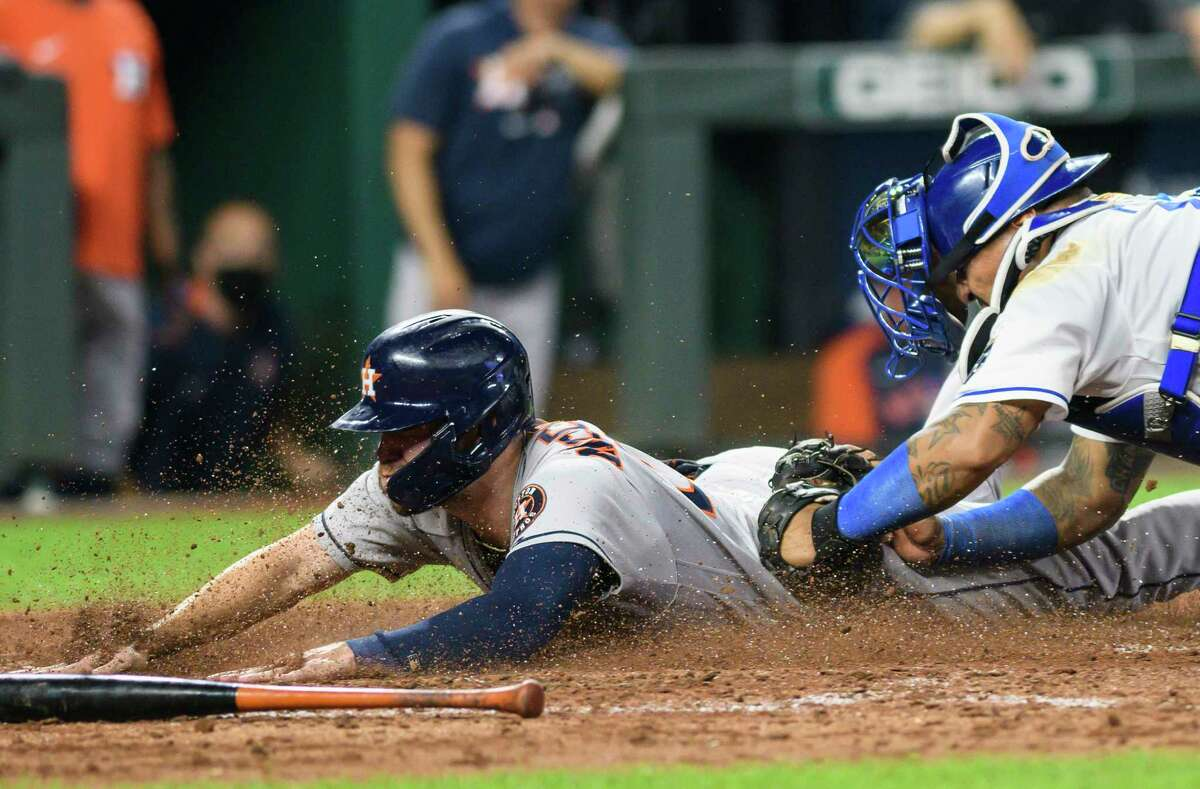 Astros runner Chas McCormick is tagged out by Royals catcher Salvador Perez trying to score on Jose Altuve's single to end Kansas City's 3-2 victory Wednesday