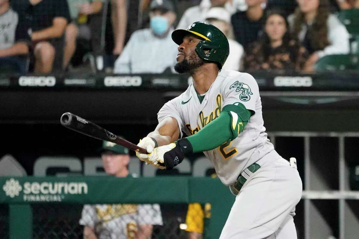 Oakland Athletics' Starling Marte watches his RBI sacrifice fly off Chicago White Sox relief pitcher Ryan Tepera during the seventh inning of a baseball game Wednesday, Aug. 18, 2021, in Chicago. (AP Photo/Charles Rex Arbogast)