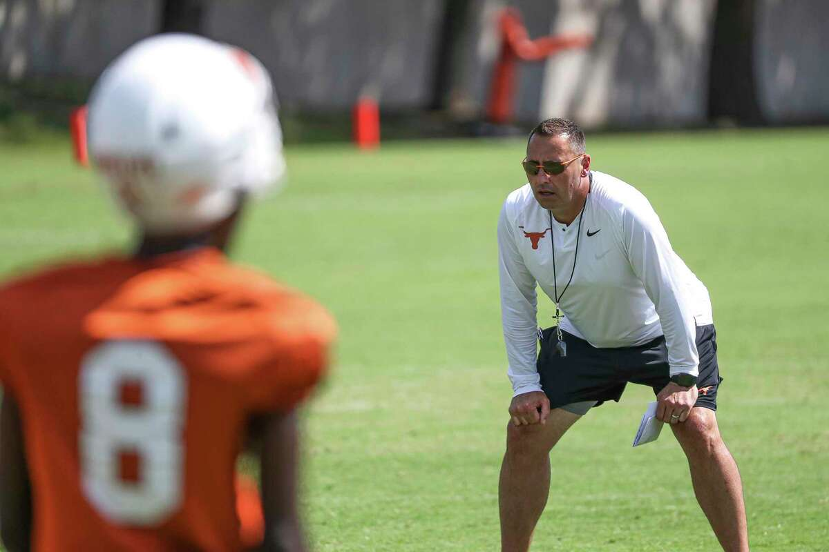 Texas head coach Steve Sarkisian watches his players run through drills during practice Saturday, Aug. 7, 2021, in Austin.