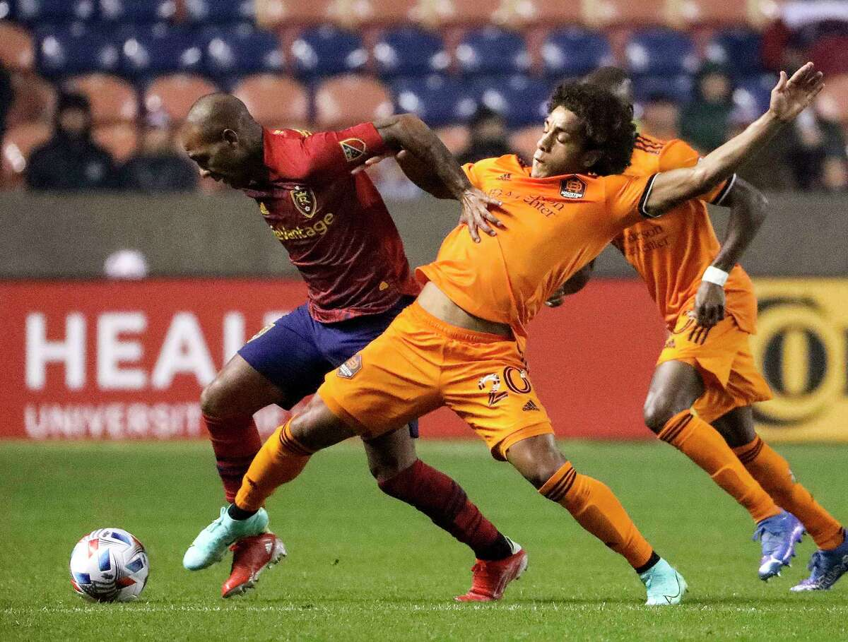 Real Salt Lake midfielder Everton Luiz (left) and the Dynamo's Adalberto Carrasquilla compete for the ball during Wednesday's match in Sandy, Utah.