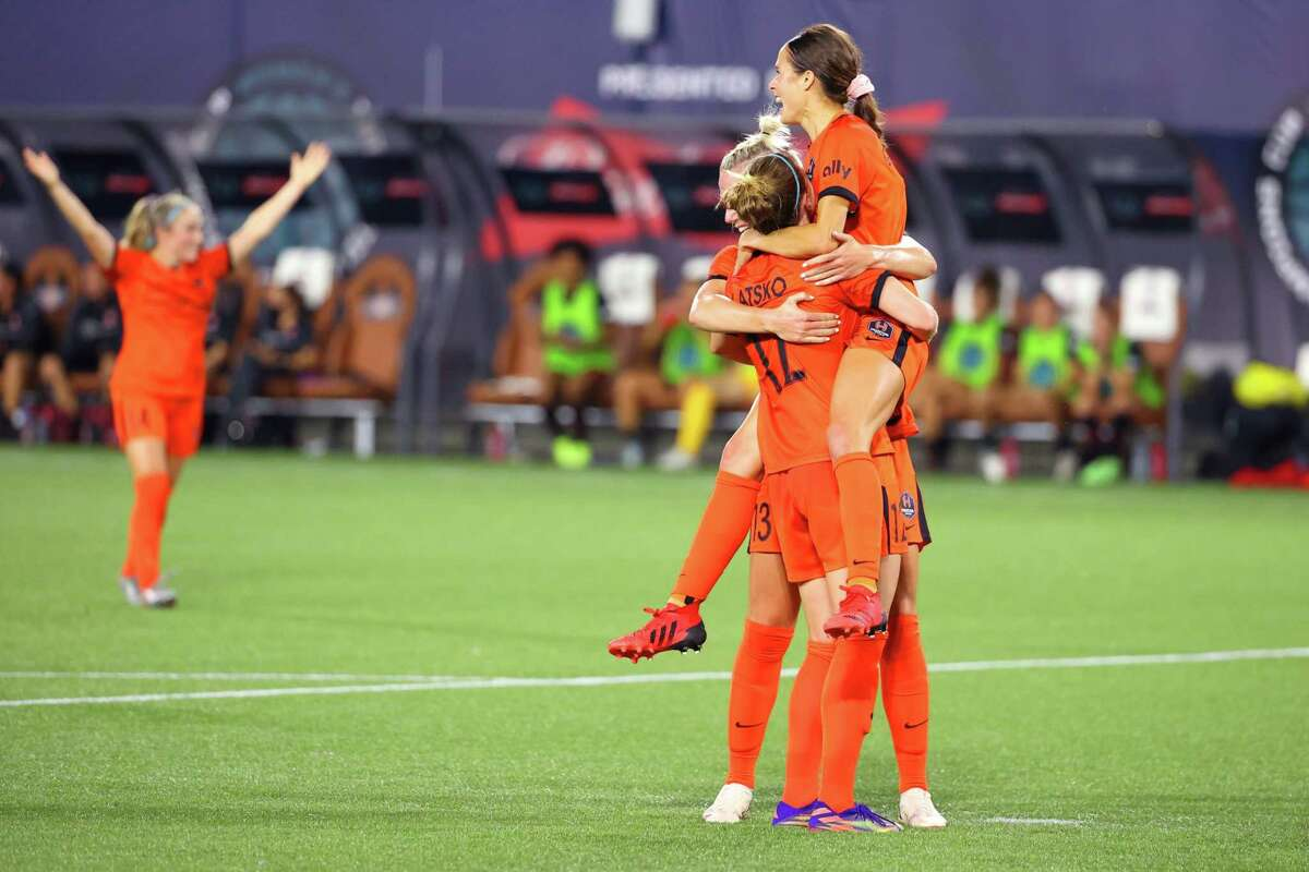 Shea Groom of the Dash celebrates with teammates after scoring her second goal in Wednesday's Women's International Champions Cup semifinal against the Thorns in Portland.