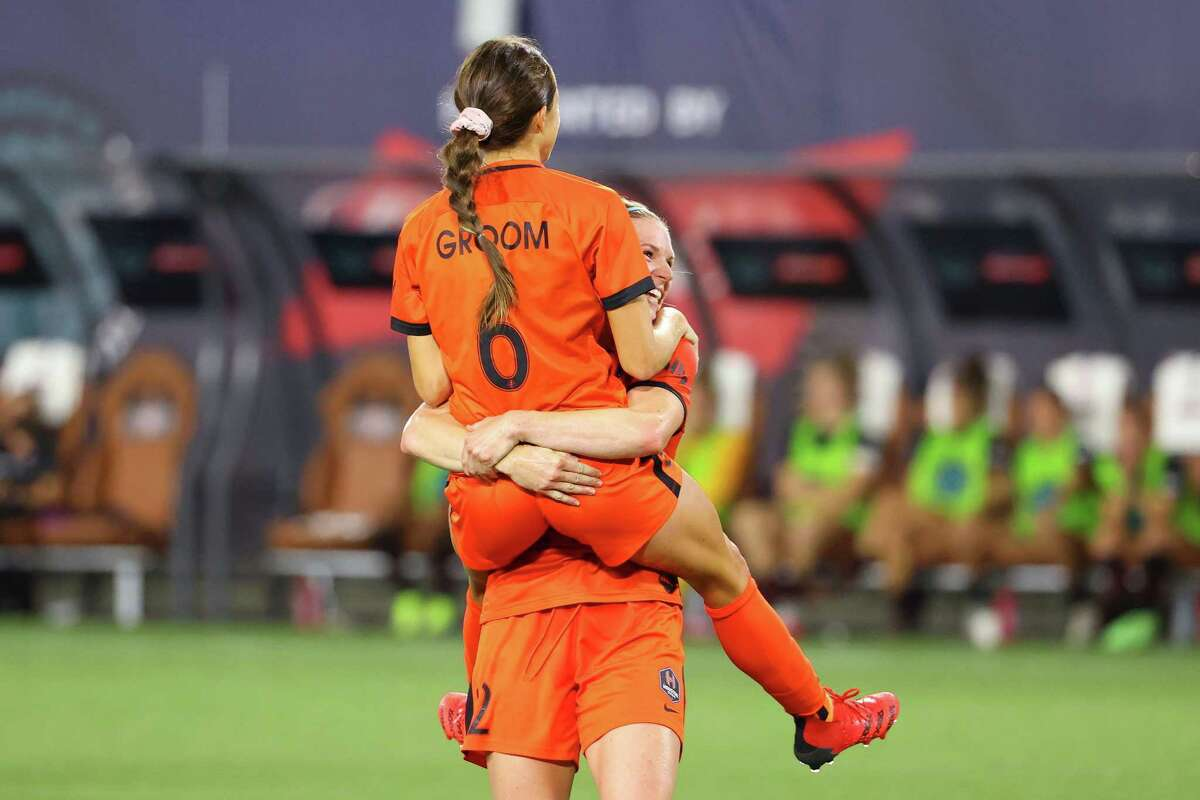 Shea Groom celebrates with Dash teammate Veronica Latsko after scoring her second goal during the Women's International Champions Cup semifinal between the Dash and Portland Thorns on Thursday.