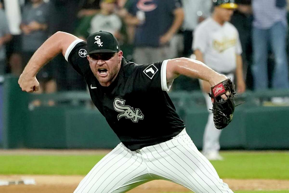 Chicago White Sox relief pitcher Liam Hendriks reacts after striking out Oakland Athletics' Jed Lowrie to end the baseball game Wednesday, Aug. 18, 2021, in Chicago. The White Sox won 3-2. (AP Photo/Charles Rex Arbogast)