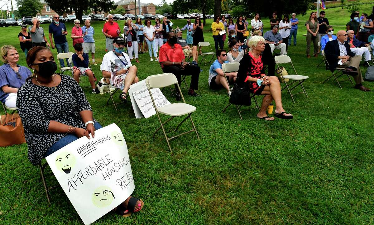 Supporters of fair housing attend the Westport's Department of Human Services, The Westport Housing Authority, and Homes With Hope call-to-action rally to address Fairfield County's growing housing crisis during the pandemic at Jesup Green Wednesday, August 18, 2021, in Westport, Conn.