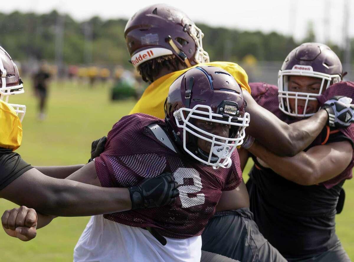 Summer Creek defensive lineman Rocky Jac (2) practices defensive line drills during football practice at Summer Creek High School, Wednesday, Aug. 11, 2021, in Houston.