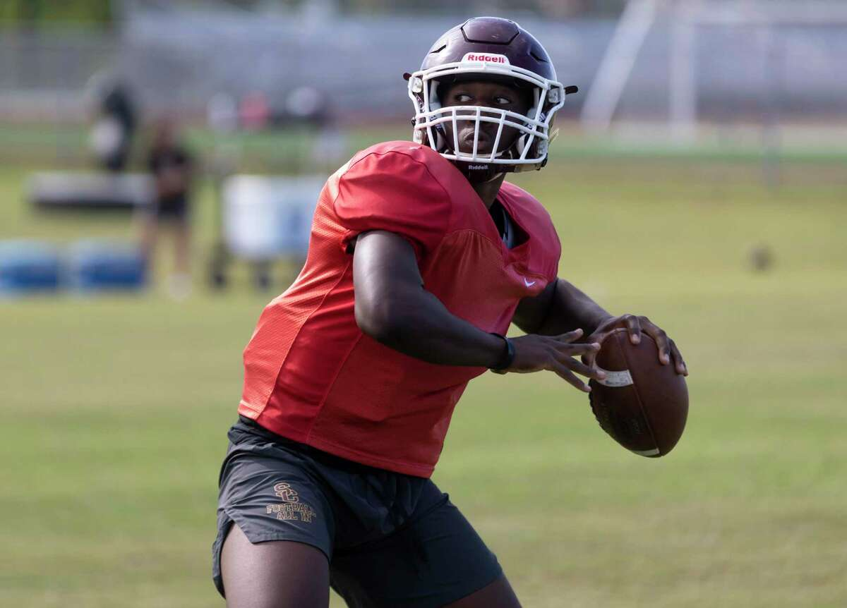 Summer Creek quarterback Jahrik Jones prepares to throw the ball during football practice at Summer Creek High School, Wednesday, Aug. 11, 2021, in Houston.