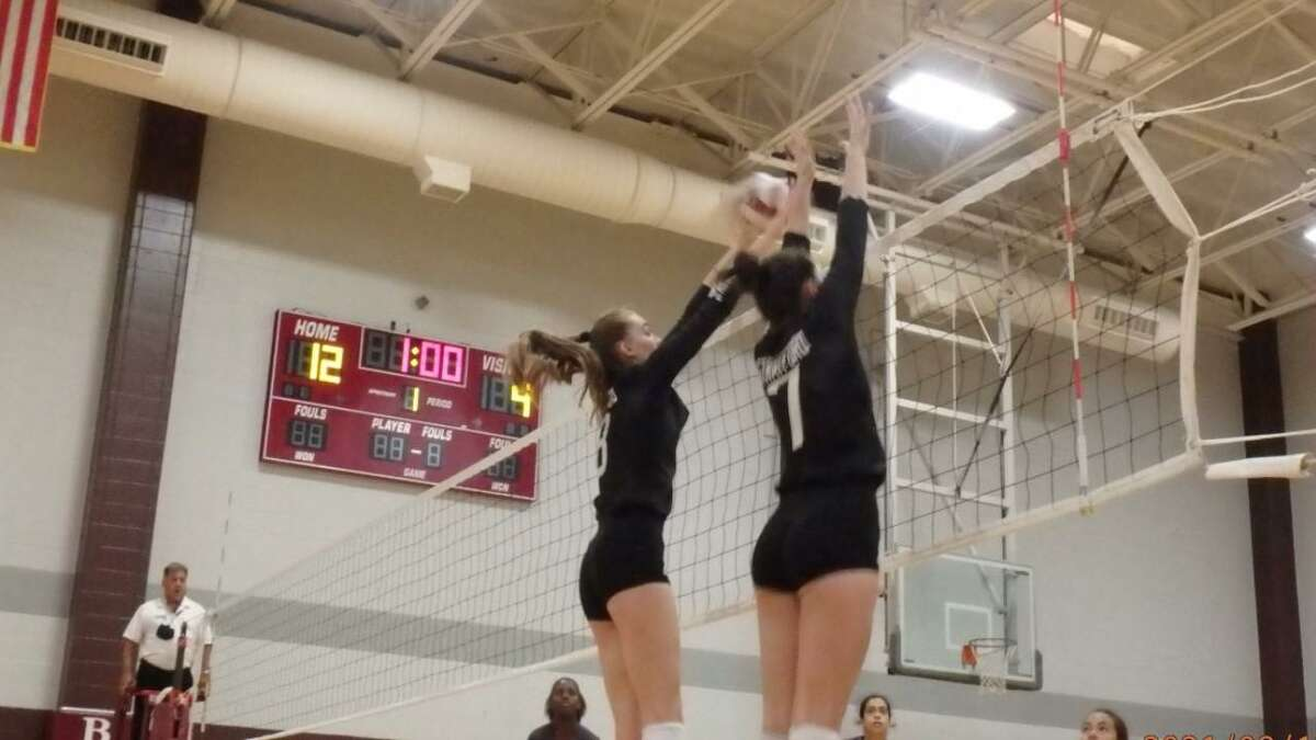 Two Stratford volleyball players go up for a block during a tournament match on Aug. 12.