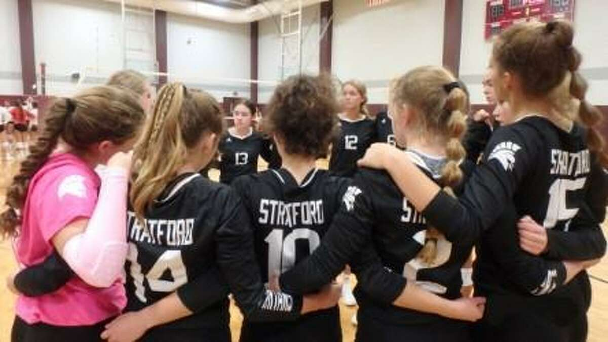 The Stratford volleyball team huddles during a tournament game on Aug. 12.