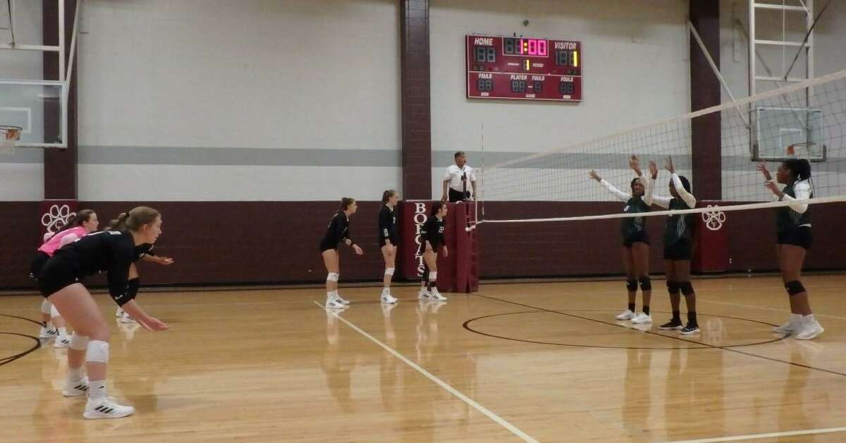 The Stratford volleyball team (left side of the court) awaits a serve during a tournament match on Aug. 12.