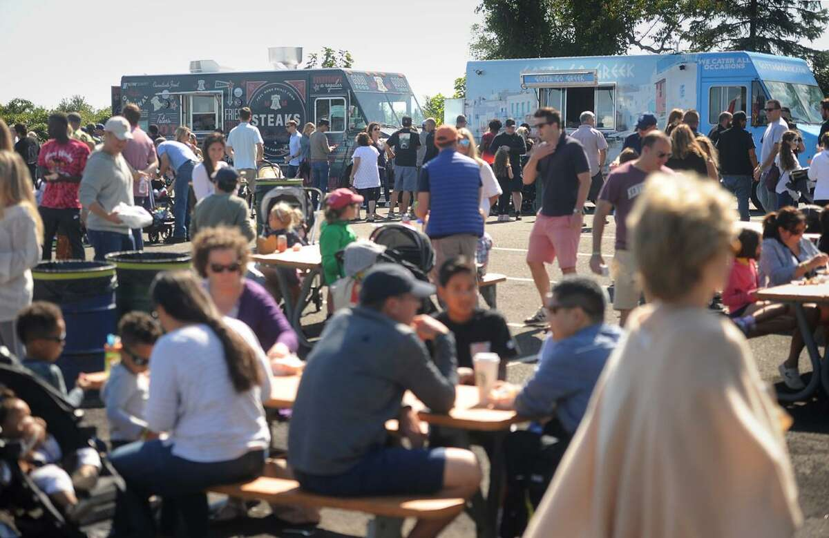 The Fairfield Food Truck Festival is returning to Fairfield from 11 a.m. until 6 p.m. on Sunday, Oct. 3, at Jennings Beach in the town, after a one year absence because of the coronavirus pandemic, and following the recent approval of the Friends of the Fairfield Public Library's application by the Fairfield Parks and Recreation Commission to have the festival. The rain date of the festival is Sunday, Oct. 10. Pictured is a photo of attendees at a previous festival.
