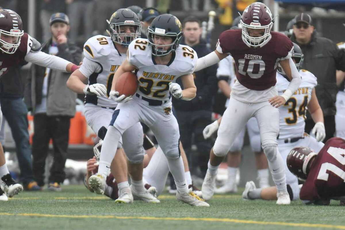 Weston's Brad Barcello runs the ball during the Class M state championship game against Killingly on Saturday, Dec. 14, 2019. Barcello is entering his senior year and will be in the backfield for the Trojans this season.