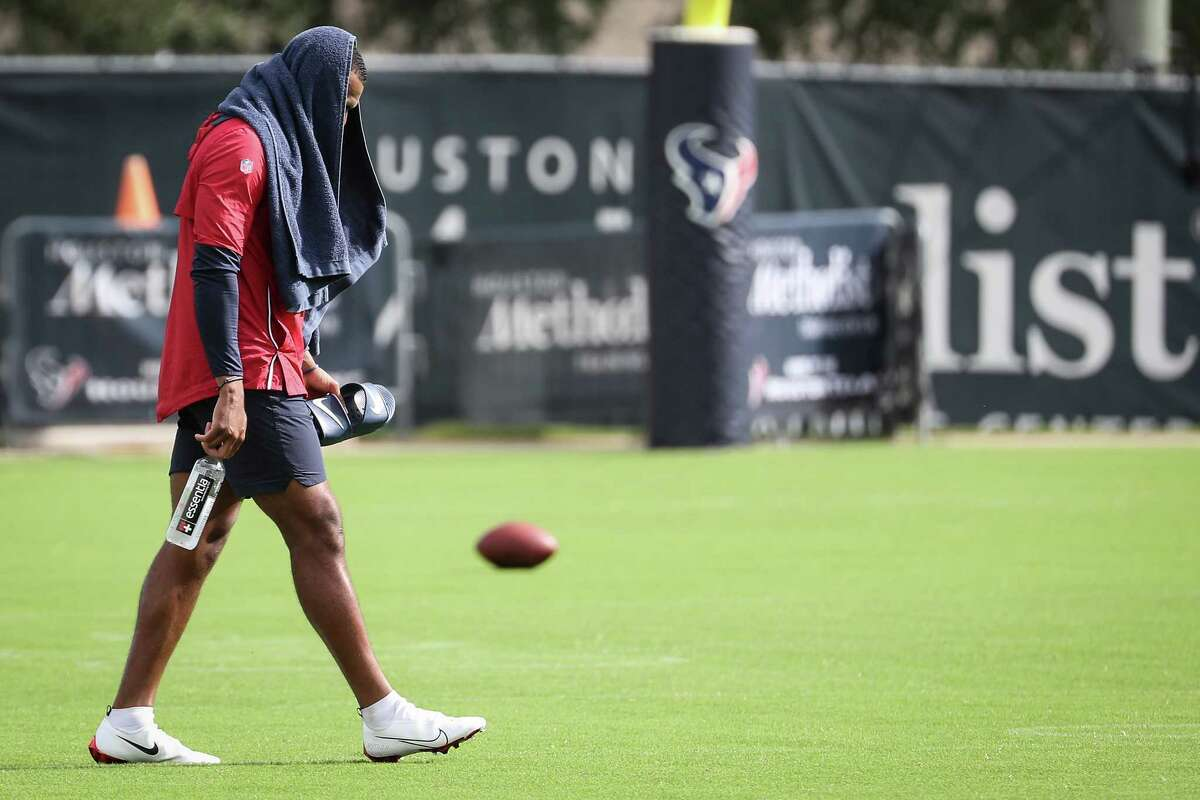 Houston Texans quarterback Deshaun Watson walks across the field to work out on the side during an NFL training camp football practice Thursday, Aug. 19, 2021, in Houston.