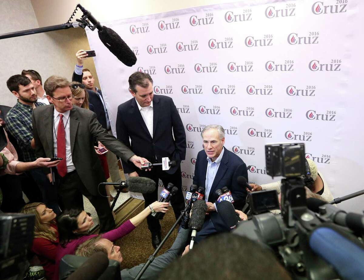 """Texas Gov. Greg Abbott, center right, speaks with Sen. Ted Cruz, R-Texas, during a press conference after a rally at Mach Industrial Group Wednesday, Feb. 24, 2016, in Houston. Cruz came in third place in the recent Nevada Caucus, and spoke about the upcoming """"Super Tuesday"""" contests. ( Jon Shapley / Houston Chronicle )"""