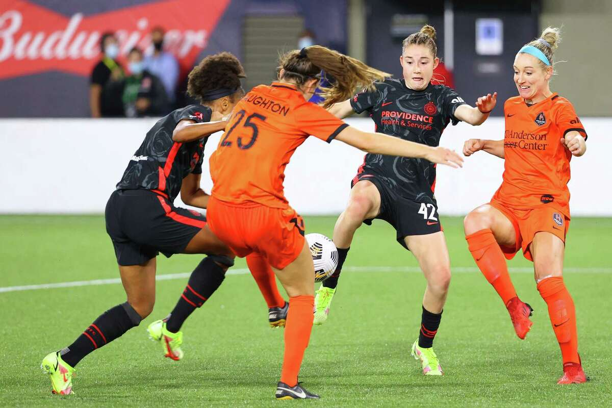 PORTLAND, OREGON - AUGUST 18: Olivia Moultrie #42 of Portland Thorns FC controls the ball against Katie Naughton #25 of Houston Dash in the second half during the Women's International Champions Cup semifinal between the Houston Dash and Portland Thorns at Providence Park on August 18, 2021 in Portland, Oregon.
