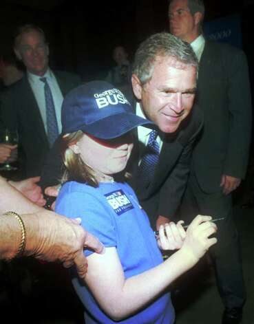 2000: Governor George W. Bush of Texas poses for a picture with Shayne Sullivan at a fund raiser for the Connecticut Republican Party at the Westin Hotel in Stamford. Photo: File Photo / Stamford Advocate File Photo