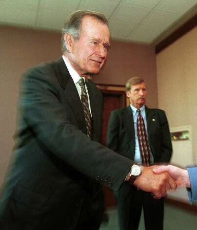 1999: Former President George H.W. Bush greets fans after reading excerpts from his new book at the Just Books breakfast in the Westin Hotel in Stamford. Photo: File Photo / Stamford Advocate File Photo