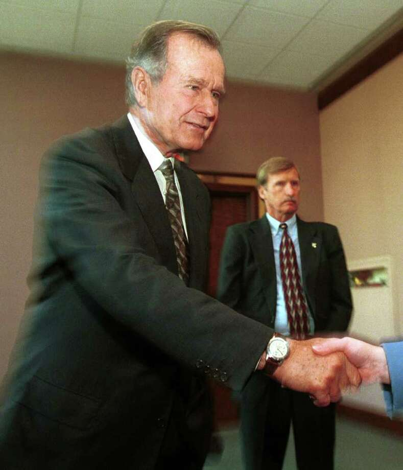 1999: Former President George H.W. Bush greets fans after reading excerpts from his new book at the Just Books breakfast in the Westin Hotel. Photo: File Photo / Stamford Advocate File Photo