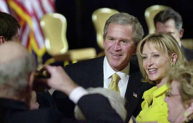2002: President George W. Bush stops to have his picture taken with Elizabeth Hirsch of Greenwich at the Hyatt in Greenwich. Taking the photo was state Senator William H. Nickerson. Photo: File Photo / Stamford Advocate File Photo