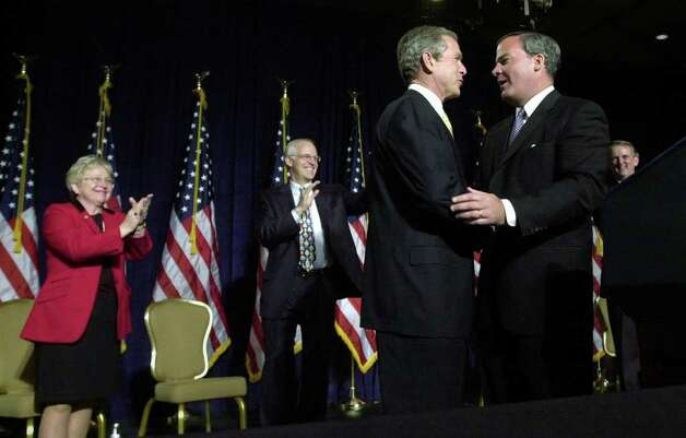2002: Governor John Rowland welcomes President George W. Bush to the Hyatt Regency in Greenwich. In the background are sixth district US Rep. Nancy Johnson, R-New Britain, and fourth district Congressman Christopher Shays, R-Bridgeport. Photo: File Photo / Stamford Advocate File Photo