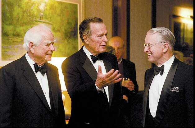2000: Former US President George Bush talka with his brother, Prescott Bush (right) and founder of Pepsico, Don Kendall (left) at a reception for the USA-China Chamber of Commerce which was held at the Hyatt Regency in Greenwich. Photo: File Photo / Stamford Advocate File Photo