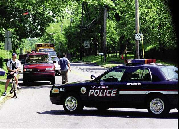 2000: A Greenwich police car blocks northbound traffic on King Street  just south of the King Street interchange at the Merritt Parkway as the President Bill Clinton's motorcade makes its way onto the east-bound lane of the Merritt Parkway. Photo: File Photo / Stamford Advocate File Photo